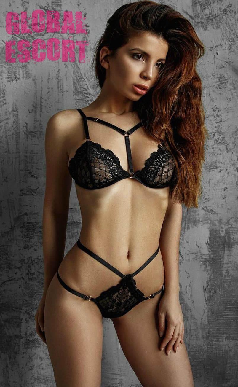 beautiful escort model posing in transparent black lingerie