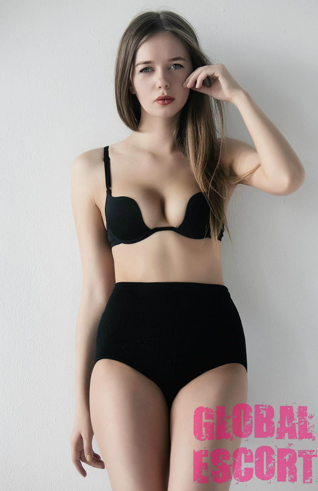 escort model Svetlana in black lingerie posing at a photo shoot