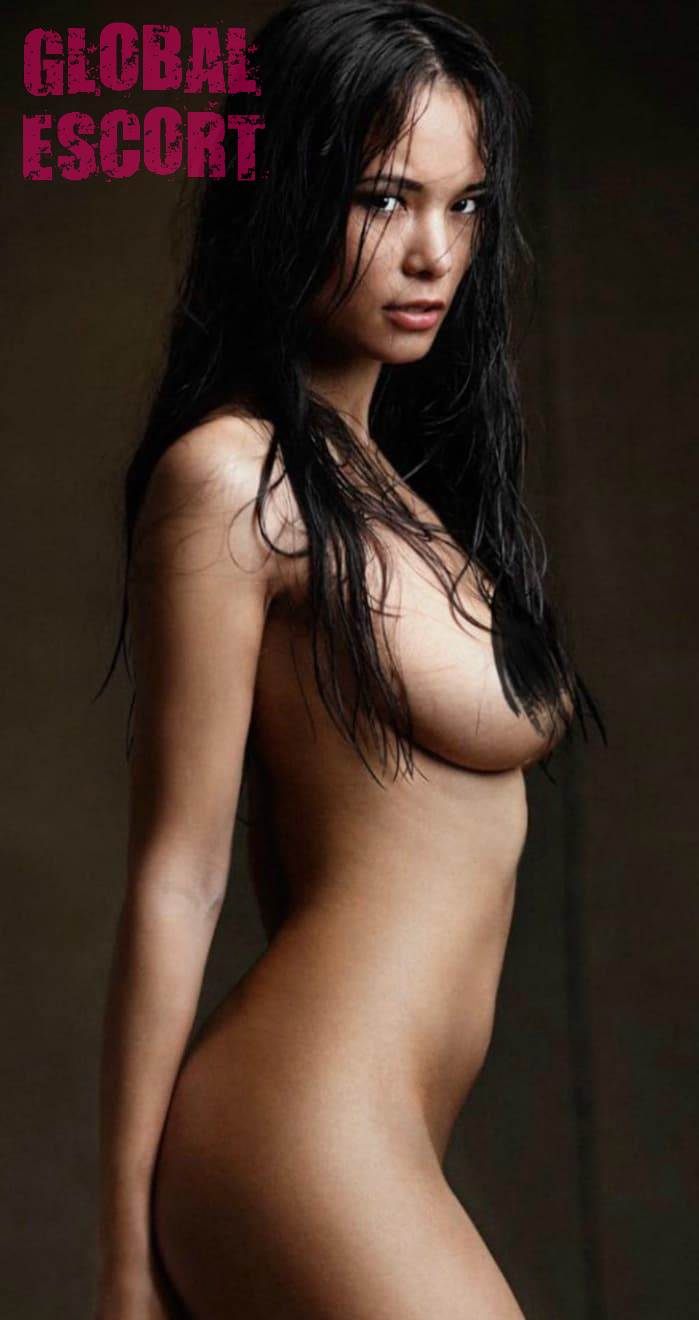 naked brunette at a photo shoot on a black background