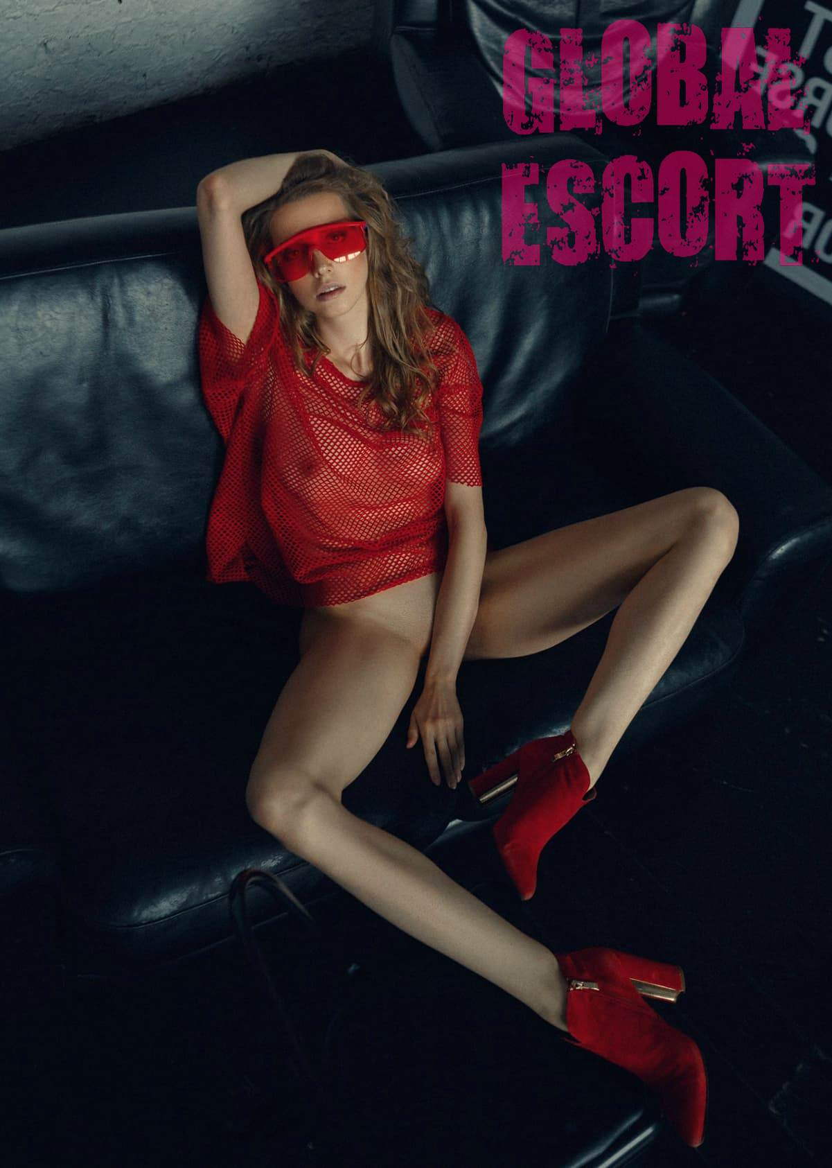 naked sexy escort Model Ekaterina in a transparent red sweater and red glasses