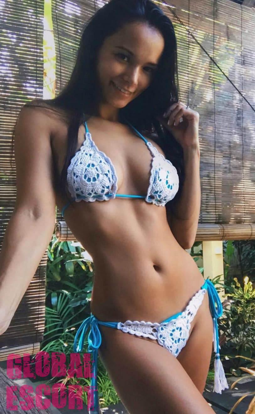 sexy brunette in a blue swimsuit