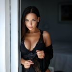 sexy model Angelina in black lingerie on the balcony