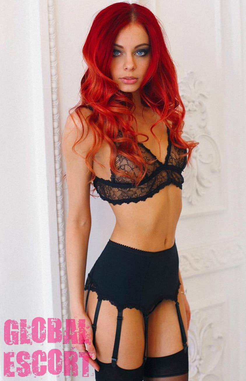 sexy redhead escort model posing in beautiful black lingerie