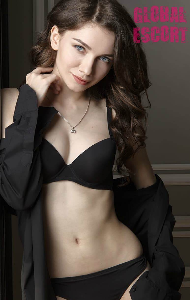 young brown-haired woman in a black lingerie photo shoot